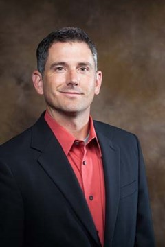 Dr. Brian E. Haggard