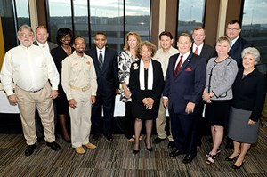 (L to R): Archie Schaffer, Tyson Foods; Mike Kidd, U of A poultry science; Paula Johnson, UAPB student; Rashad Delph, Tyson Foods; Laurence Alexander, UAPB chancellor; Sharon Gaber, U of A provost; Mary Benjamin, UAPB vice chancellor; Russell Tooley, Tyson Foods; Mike Vayda, Bumpers College dean; Monty Henderson, George's Inc.; Lona Robertson, Bumpers College; Frank Myers, Simmons Foods;  Linda Okiror, UAPB.