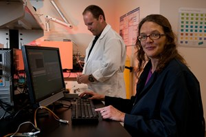 SFC Fluidics researchers Brad Ledden (left) an associate scientist, and Anna Washburn, project manager.