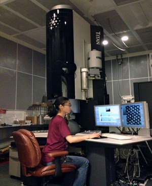 Physics doctoral student Ann Xian Hu operates the FEI Titan TEM in the Institute for Nanoscience and Engineering at the University of Arkansas