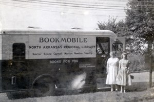 Two women with the North Arkansas Regional Library Bookmobile, 1956. (Woman's Book Club of Harrison (MC 843), University of Arkansas Libraries, Fayetteville.)