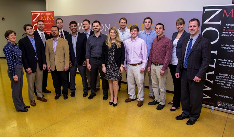 Carol Reeves, associate vice provost for entrepreneurship at the University of Arkansas (far left), is joined by students on 2014 U of A business plan competition teams: Brad Phelan (left to right), Jason Kohrig, Randy Espinal Cabrera, Justin Urso, Neil Bora, Joe Huff, Andrew Boehm, Jackie Frentz, Scott Andrews, Trevor Ferguson, Will Gilbrech and Michael Iseman. Advisers Maria Driesel and Jeff Amerine are on the far right. Students not pictured: Mike Finan and Randi Cruz