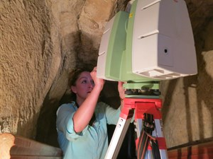 Caitlin Stevens, a researcher at the Center for Advanced Spatial Technologies at the University of Arkansas, programs a laser scanner inside the burial chamber in the Meidum pyramid. Photo courtesy Atlantic Productions