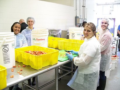 Visiting Brazilian students on the spaghetti sauce production line in the Arkansas Food Innovation program.