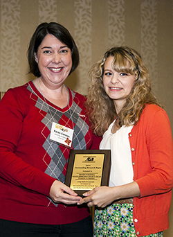 Amanda Northfell (right) receives the Association for Communication Excellence in Agriculture, Natural Resources, and Life and Human Sciences Outstanding Research Paper award from ACE Research Vice-Chair Karen Cannon.