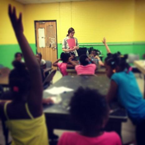 Meredith Rowlett of Mountain Home, a new Arkansas Teacher Corps Fellow, works with children in summer school in El Dorado.
