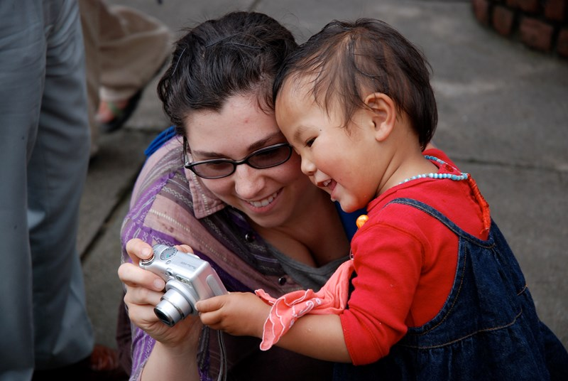 TEXT student Jessica Estenssoro with a Tibetan child.