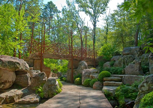 The Evans Children's Adventure Garden at Garvan Woodland Gardens offers many paths and boulders for exploring this summer.