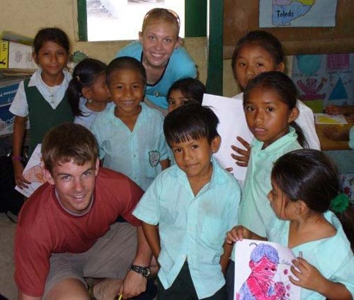 U of A students connect with schoolchildren on a previous trip to Belize.