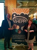 Director Quincy Spencer and Assistant Director Alison Leach accept the Powerful Partnership Award and the Excellence in Publication-Website Award at the AHEPPP Annual Conference.