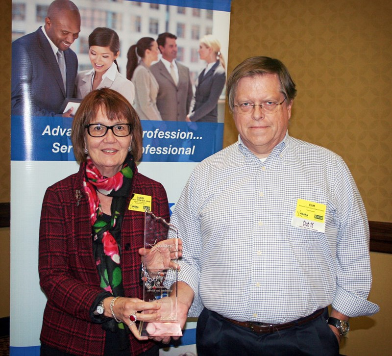 Judith Tavano of the Global Campus accepts the Human Resource Professional of the Year Award for 2015 from Cliff Sandsmark, past president of the Northwest Arkansas Human Resource Association.