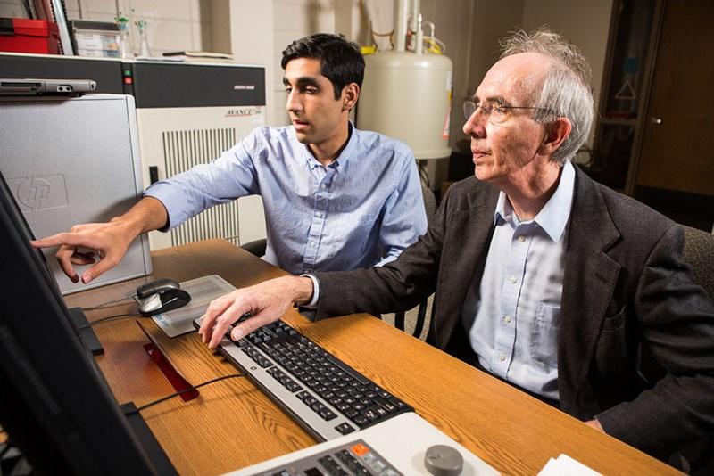 Armin Mortazavi and faculty mentor Roger Koeppe examine deuterium magnetic resonance (NMR) results. Photo: Matt Reynolds.