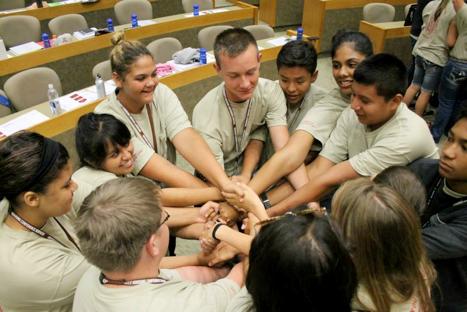 Native Youth in Agriculture Summer Leadership Summit students Jackson Smith (Cayuse Umitilla), Alayna Rhodes (Bad River Ojibwa), Aryana Henthorne (Sherwood Valley Pomo/Paiute), Laura Bergman (Cherokee), Zack Ilbery (Cherokee), Kayden Murphy (Navajo), Lofanitani Aisea (Klamath), Matthew Butler (Sac&Fox/Absentee Shawnee), and Aukelenui Mortensen (Hawaiian) participate in a team-building exercise during the 2015 summit held on the University of Arkansas Fayetteville campus.