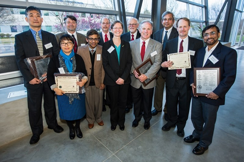 University of Arkansas faculty honored at the Inventors Appreciation Banquet Wednesday included Jia Di (front row, from left), Marty Matlock, Xianghong Qian, Ranil Wickramasinghe, Ingrid Fristch, Ralph Henry, Scott Osborn and Hameed Naseem. Congratulating the inventors were University of Arkansas System President Donald R. Bobbitt (back row, from left), U of A Chancellor Joe Steinmetz and U of A Provost Ashok Saxena.
