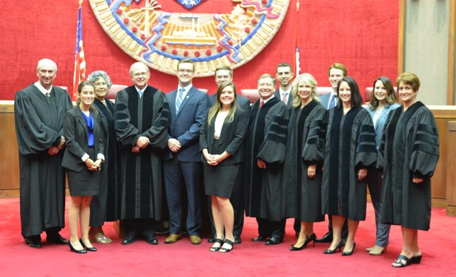 From left, Associate Justice Paul E. Danielson, Victoria Medina, Associate Justice Josephine Hart, Chief Justice Howard W. Brill, James Stayton, Eric Eggburn, Caroline Currier, Associate Justice Robin F. Wynne, Russell Thomas (Goodson extern from Florida), Associate Justice Courtney Hudson Goodson, Matthew Light, Associate Justice Rhonda K. Wood, Caitlin Kenner and Associate Justice Karen R. Baker