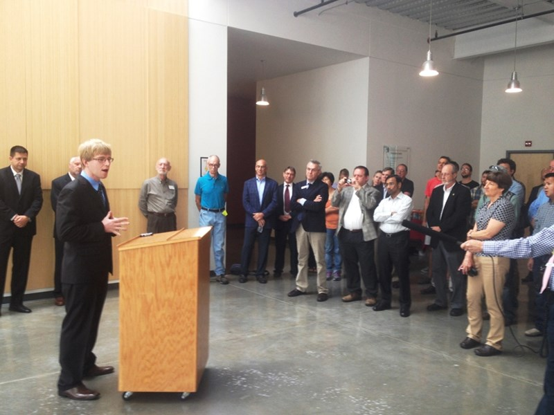 Picasolar CEO Douglas Hutchings announces the company's SunShot Incubator Award at the Arkansas Research and Technology Park on on Wednesday.