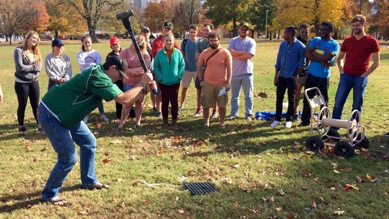 Undergraduate students in a petroleum geophysics class participate in measurement of seismic activity.