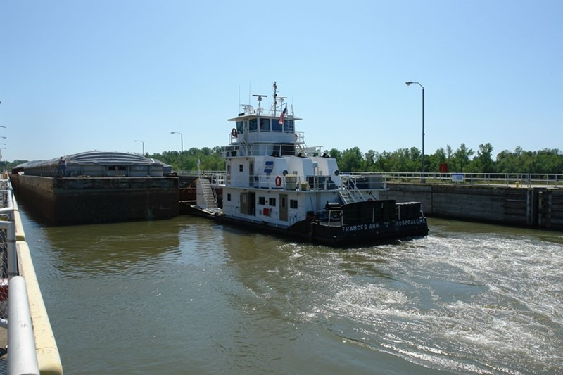 A tugboat and barge in the McClellan-Kerr Arkansas River Navigation System.