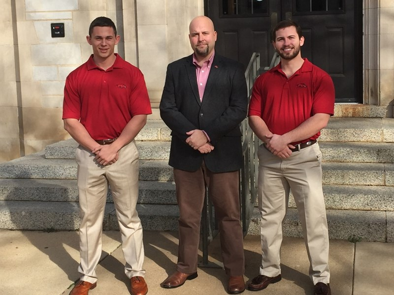 From left, Colson Tester, instructor Nathan Kemper and Luke Lane outside of the Agriculture Building following their victories at the Academic Quiz Bowl Competition.