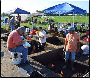 Amateur archeologists join a dig.