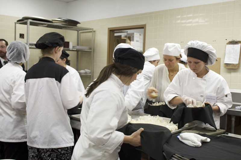 Hospitality innovation students in Bumpers College plan, prepare and serve a fine dining event.