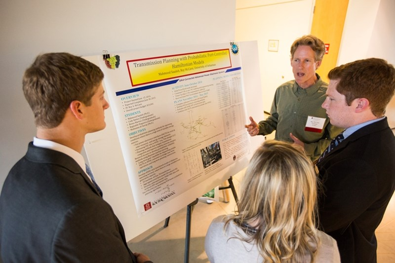Researchers explain and discuss their work at a recent Research Showcase.