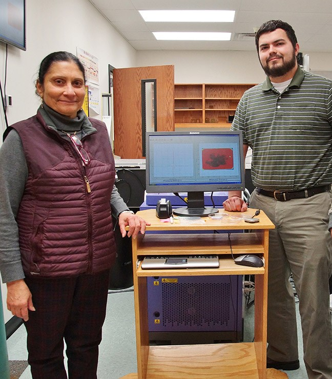 Professor Magda El-Shenawee and graduate assistant, Tyler Bowman, use THz imaging technology to assess the margins of cancerous breast tumors.
