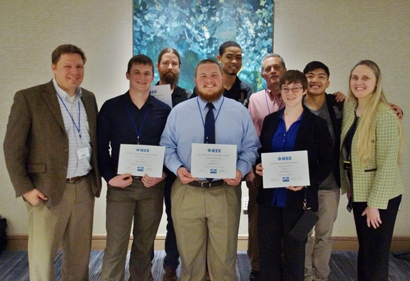 Electrical engineering students at the IEEE Region 5 meeting. The department took two first-place titles and one second-place title in the oral presentation and written paper competition and the circuits design competition. Students pose with Matt Francis, section chair, Silke Spiesshoefer, vice president, and Robert Saunders, section treasurer.