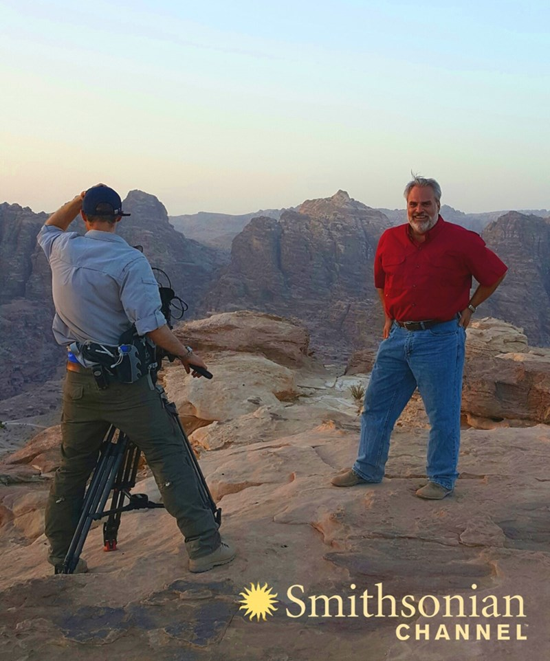 Thomas Paradise being filmed atop Jebel Madbah, the High Place of Sacrifice, above the Valley of Petra.