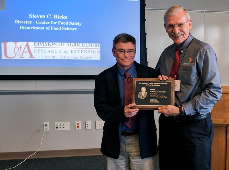 Steven Ricke receives the W.C. Frazier Memorial Lectureship award May 17 from Charles J. Czuprynski, director of the Food Research Institute at the University of Wisconsin-Madison.