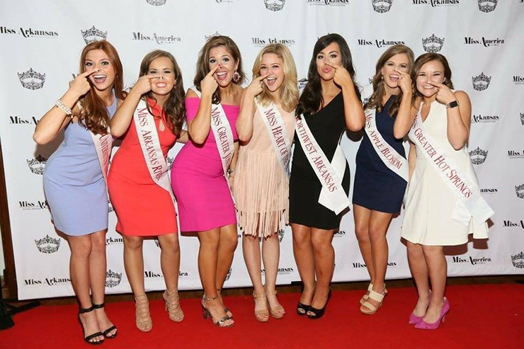 Seven of the eight University of Arkansas competitors who will be vying for Miss Arkansas 2017 show their Razorback pig nose.