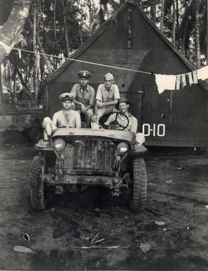 """Neil Compton on Guadalcanal."" Compton in 1944 (back row, on right).  From 40-50-100: Milestones in Arkansas's Environmental History, University of Arkansas Libraries, Fayetteville. Neil Compton Papers (MC 1091, Box 25, File 6, Image 97)."