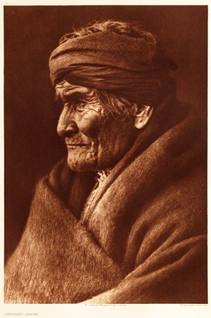"""Geronimo –  Apache."" (Photographed by Edward S. Curtis, photogravure print, brown ink, 1907, University of Arkansas Libraries Special Collections.)"