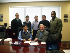 Front row (left to right) Ian Chan and Alan Mantooth; Back Row (left to right) Tim Brinkley, Tzu-Kun Ku, Simon Ang, Juan Carlos Balda and T.A. Walton, all at the ITRI signing.