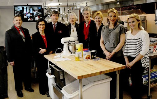 Relatives of Maudine Sanders toured the culinary kitchen teaching laboratory in the School of Human Environmental Sciences funded by part of her bequest to the University of Arkansas. Pictured are, from left, Dean Michael E. Vayda, Dale Bumpers College of Agricultural, Food and Life Sciences;  Beverly Charleton; Robert Harrington, coordinator of the foods, human nutrition and hospitality major; Wilma and Carol Sutton; Linda Hogg; Brooke Johnston and Jorja Johnston.