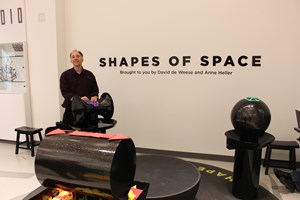 Chaim Goodman-Strauss with the Shapes of Space exhibit at the National Museum of Mathematics.