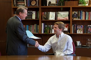 Chancellor Gearhart congratulates Nathan Coulter for his selection as a Truman Scholar.