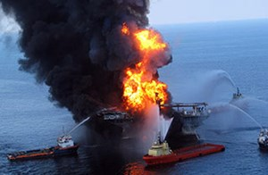 The Deepwater Horizon offshore oil drilling rig is engulfed in flames before eventually sinking.