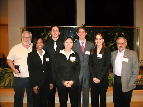 Walton College second-place team in the 2010 Operation Stimulus includes (l.to r.)  John Ozment, Ashleigh Toatley, Kameron Wilson, Yuki Hatano, Brik Heil, Sabrina Wade and Jim Crowell.