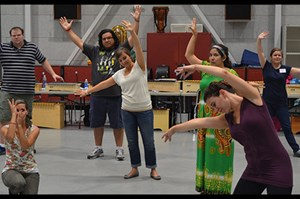 Orff workshop participants involved in a creative movement exercise.