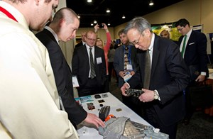 U.S. Secretary of Energy Steven Chu looks at the prototype of the silicon-carbide battery at the 2013 Energy Innovation Summit in Washington D.C.