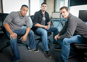 TTAGG employees include (left to right) Chuong Nguyen, Kenny Cason and Ryan Frazier. Cason, Frazier and Britt Cagnina (not pictured) co-founded TTAGG in October 2011. Photo by Russell Cothren, University of Arkansas.