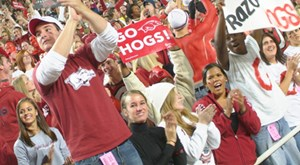 Fans cheer on the Razorbacks at Donald W. Reynolds Razorback Stadium. Arkansas plays in the Southeastern Conference, one of the athletic conferences whose champions receive an automatic berth in the Bowl Championship Series. (Photo by Russell Cothren, University Relations)