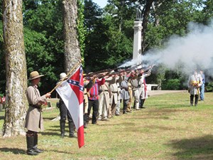 Civil War re-enactors fire a salute during a ceremony June 2 at the Confederate Cemetery on Rock Street in Fayetteville.