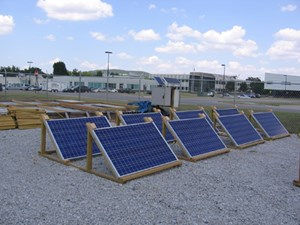 The researchers test site shows photovoltaic panels (foreground) providing power to a battery-storage system and concrete panels (background).