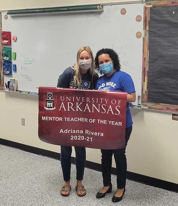Ashley Wilson, left, and teacher mentor Adrian Wilson
