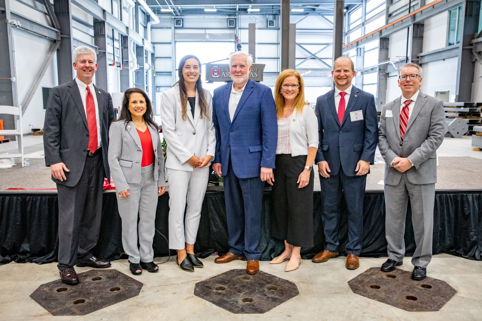 Left to right, Acting Chancellor Bill Kincaid, Dean of Engineering Kim Needy, Ph.D. student Bette Poblete, Grady E. Harvell, Stephanie Blevins on behalf of Governor Hutchinson, former representative of the 'State Andy Davis and CVEG Department Head Micah Hale