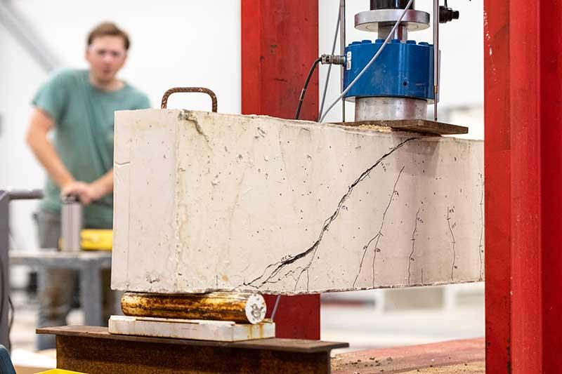 Caleb Chestnut monitors a concrete beam nearing failure