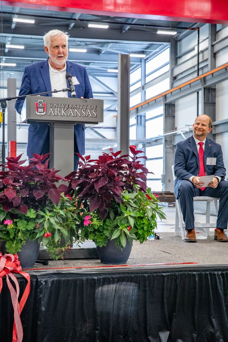 Grady E. Harvell speaks at the ceremony as Andy Davis watches.
