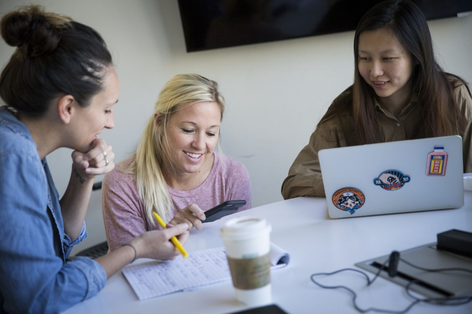 Walton College alum April Seggebruch, a co-founder of Bentonville-based Movista, mentors current students in the University of Arkansas' New Venture Development class.  (l to r) Leslie Godwin, April Seggebruch, Xiaochi Ma.  Photo credit: Garrett Hubbard